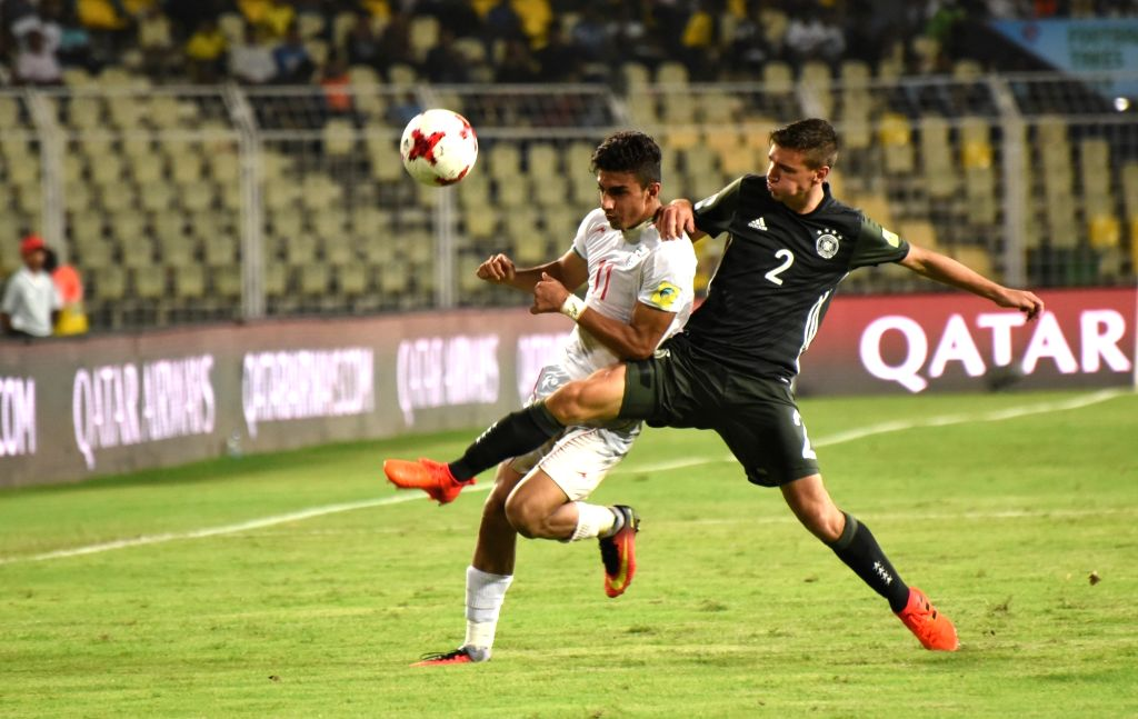 Younes Delfi (White Jersey - No.11 ) of Iran and Alexander Nitzl (Green Jersey - No.2) of Germany in action during a FIFA U-17 World Cup Group C match between Iran and Germany at Jawaharlal ...