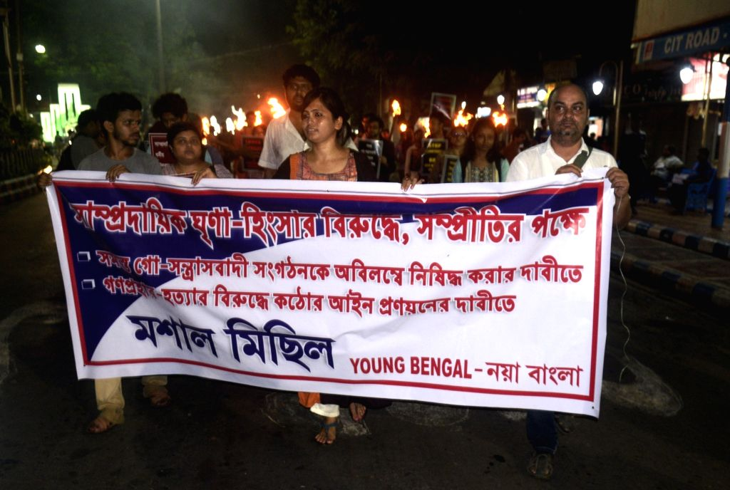 Young Bengal activists participate in a torch rally against the recent communal violence at Baduria; in Kolkata on July 4, 2017.