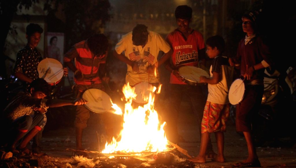 Young boys celebrate Bhogi festival -  the first day of Pongal in Chennai on Jan 13, 2017.