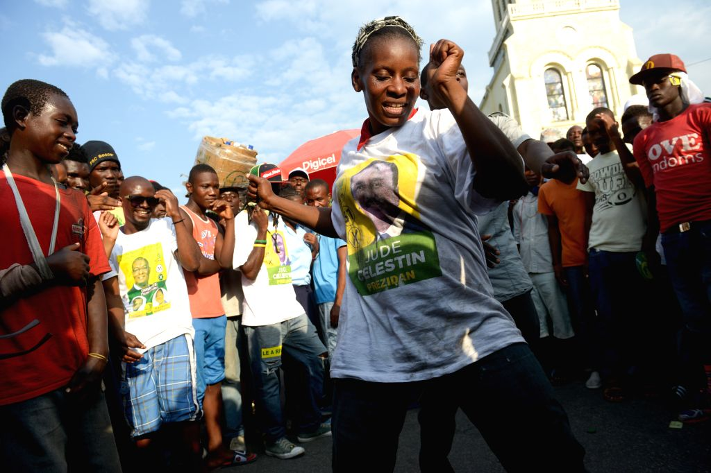 Young people dance during an electoral meeting of the presidential candidate of the Alternative League for the Progress and Emancipation of Haiti (LAPEH) ...