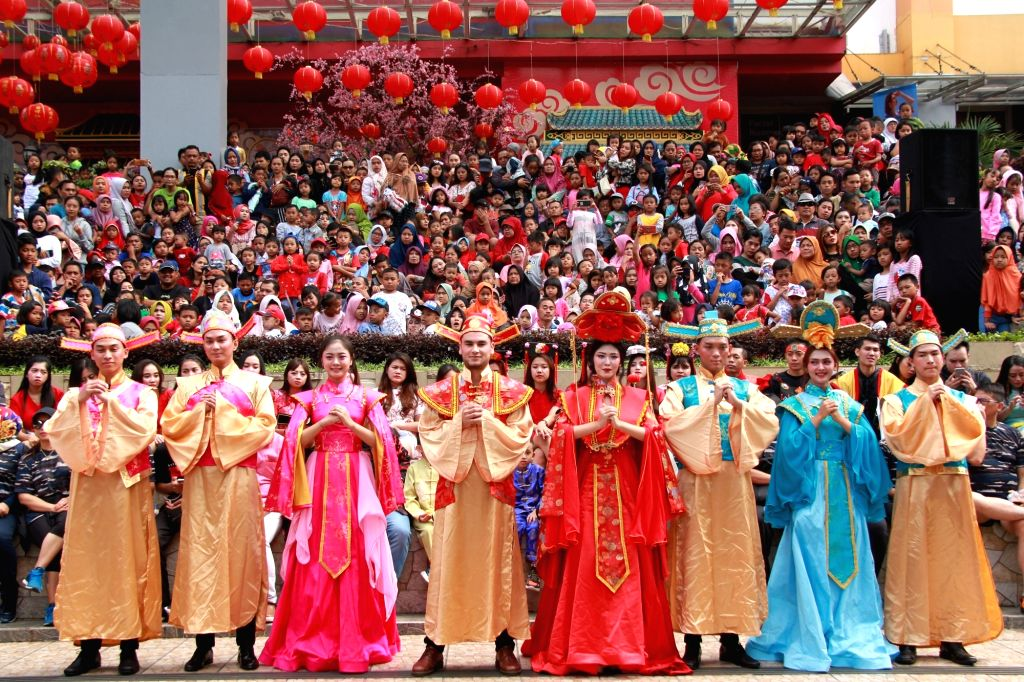 Young people wearing Chinese traditional clothes participate in a fashion show during Chinese Lunar New Year celebration in Malang, Indonesia. Jan. 25, 2020.