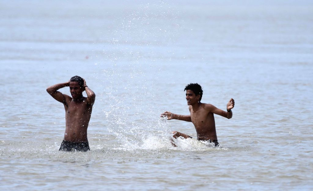 Youngsters beat the heat in Brahmaputra river on a hot day in Guwahati on May 17, 2017.