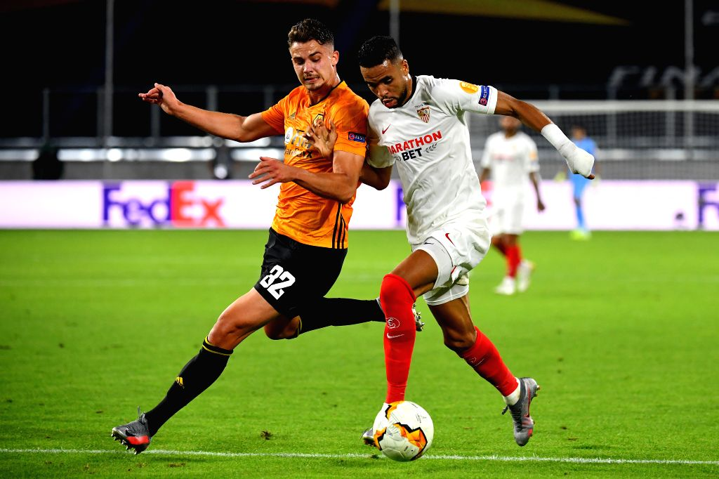 Youssef En-Nesyri (R) of Sevilla vies with Leander Dendoncker of Wolverhampton Wanderers during the UEFA Europa League quarterfinal between Wolverhampton Wanderers ...