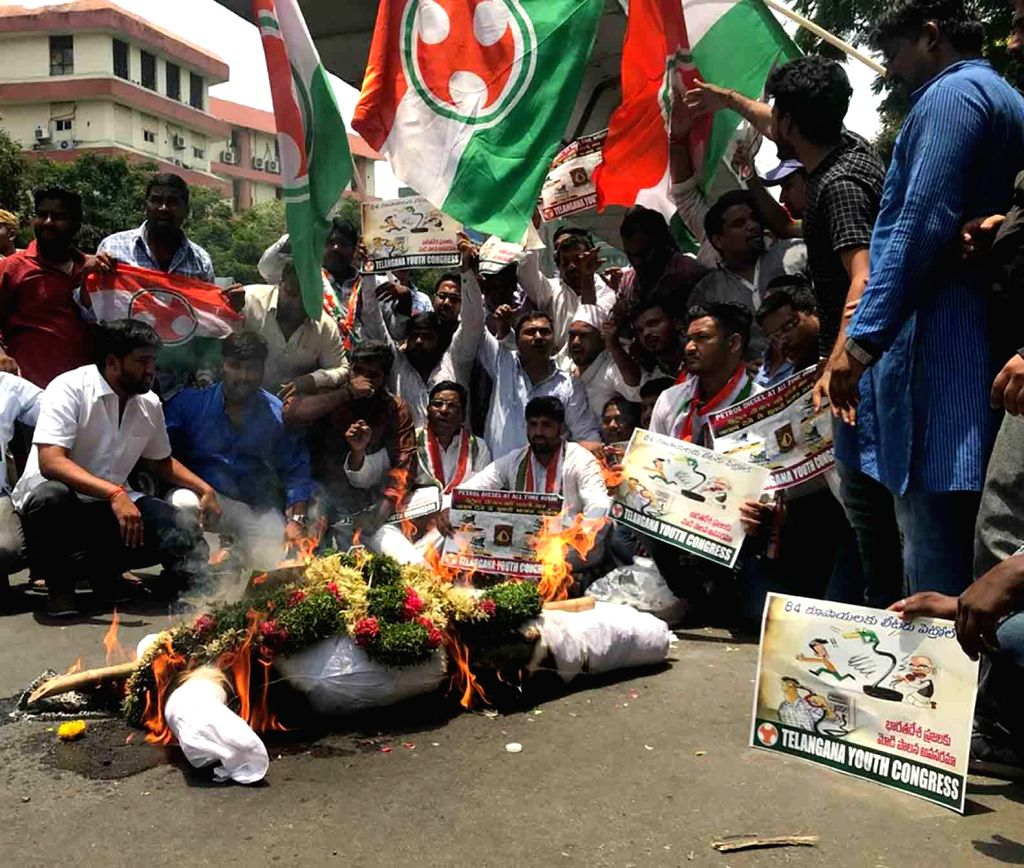 Youth activists stage a demonstration against hike in petrol prices, in Hyderabad on May 22, 2018.
