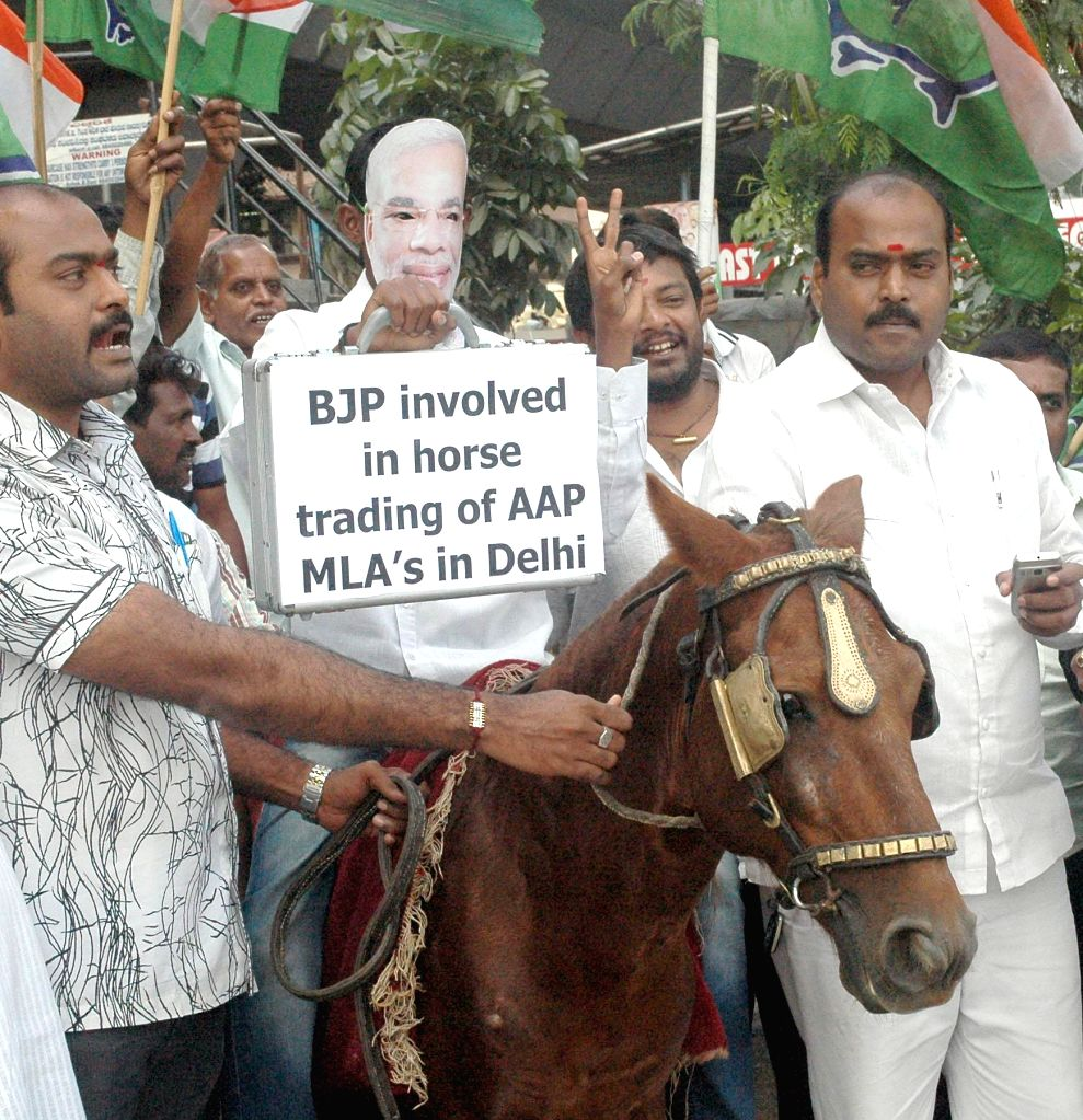 Youth Congress activists demonstrate against BJP for getting involved in alleged horse trading of legislators to form Government in Delhi, in Bangalore on Sept 9, 2014.