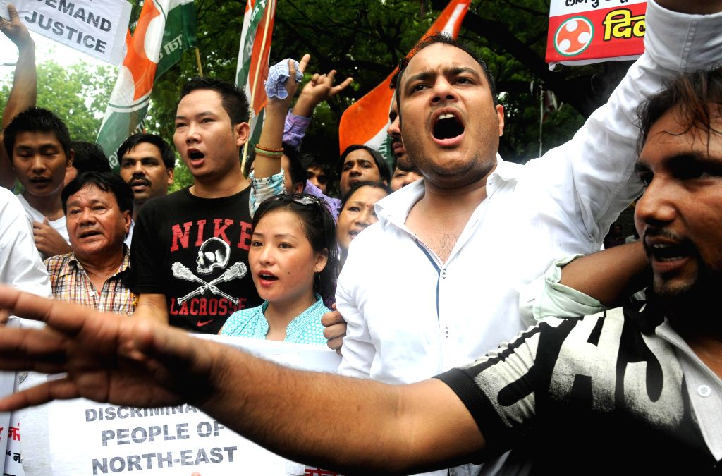 Youth Congress activists demonstrate against the alleged murder of 29-year-old Akha Salouni who hailed from North Eastern State of Manipur at Jantar Mantar in New Delhi on July 22, 2014.