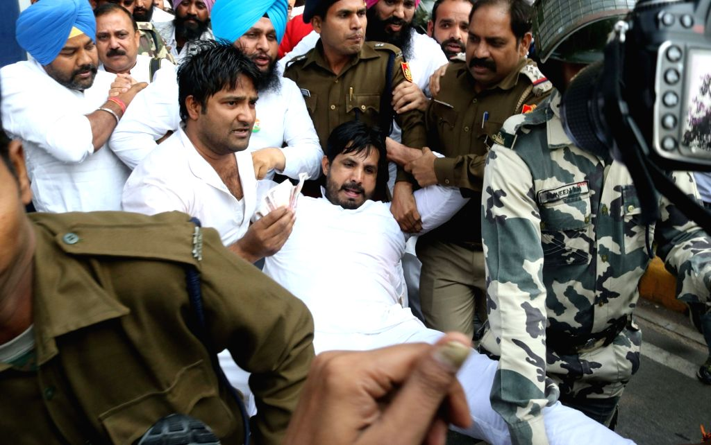 Youth Congress activists detained by police during a protest against demonetisation drive by central government in New Delhi on Nov. 18, 2016.