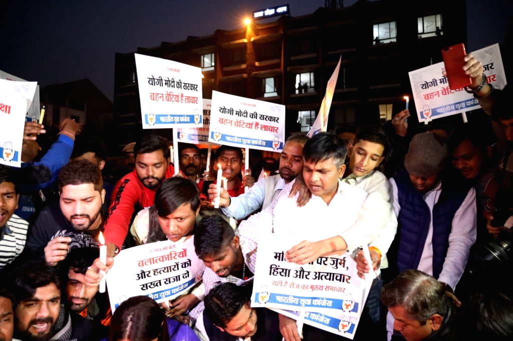 Youth Congress activists participate in a candlelight vigil to protest against the death of Unnao rape victim, highlighting the rise in incidents of crimes against women, in New Delhi on ...