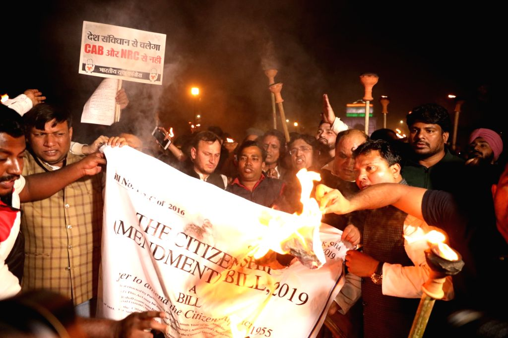 Youth Congress activists participate in a torch light procession to protest against the Citizenship (Amendment) Bill 2019, in New Delhi on Dec 11, 2019.
