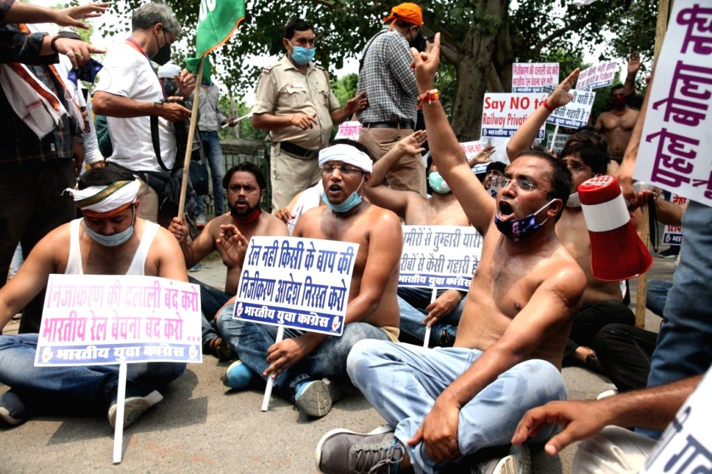 Youth Congress activists stage a demonstration against privatisation in the Railways, in New Delhi on July 3, 2020. The Railways on Wednesday announced that it has invited requests for ...