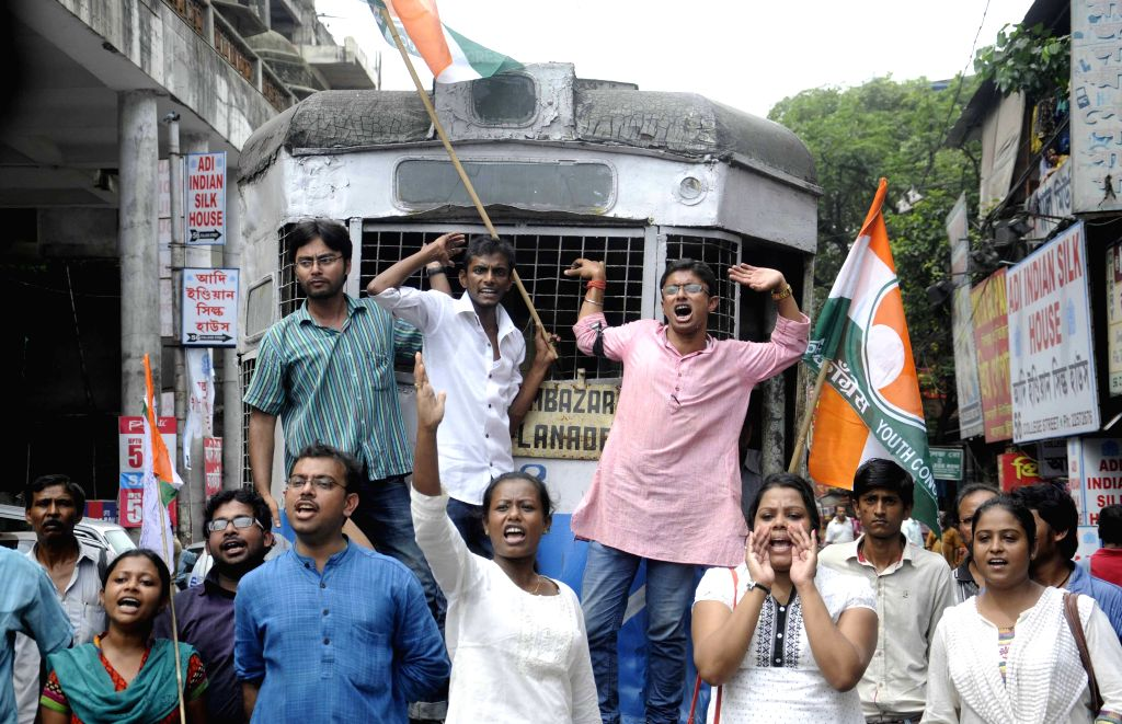 Youth Congress activists stage a demonstration against West Bengal Government in Kolkata on Aug 8, 2015.