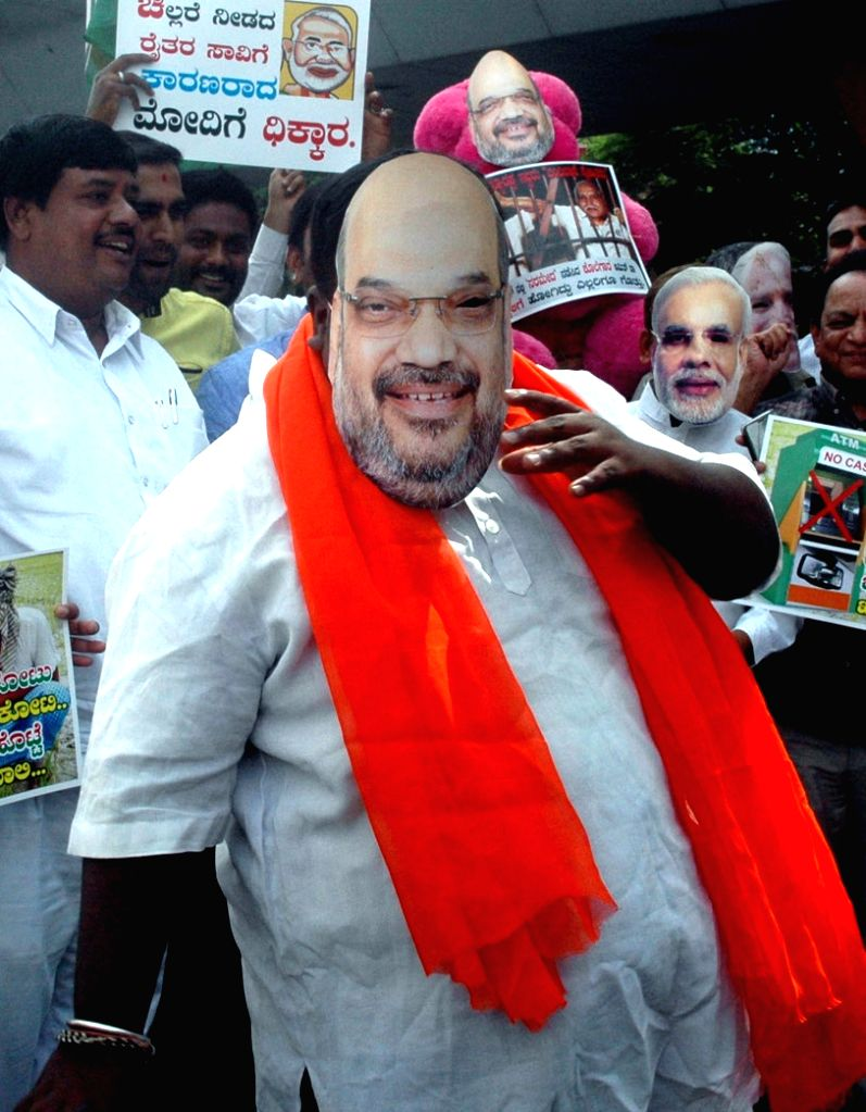 Youth Congress activists stage a demonstration against BJP chief Amit Shah over his remark on the Karnataka state Congress Government as the most corrupt govt. in Bengaluru on Nov 29, 2016. - Amit Shah