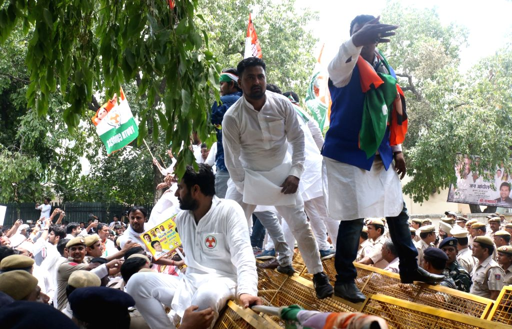 Youth Congress activists stage a demonstration against Prime Minister Narendra Modi-led BJP government during 'Bharat Bachao Jan Andolan' march, in New Delhi on May 30, 2018. - Narendra Modi