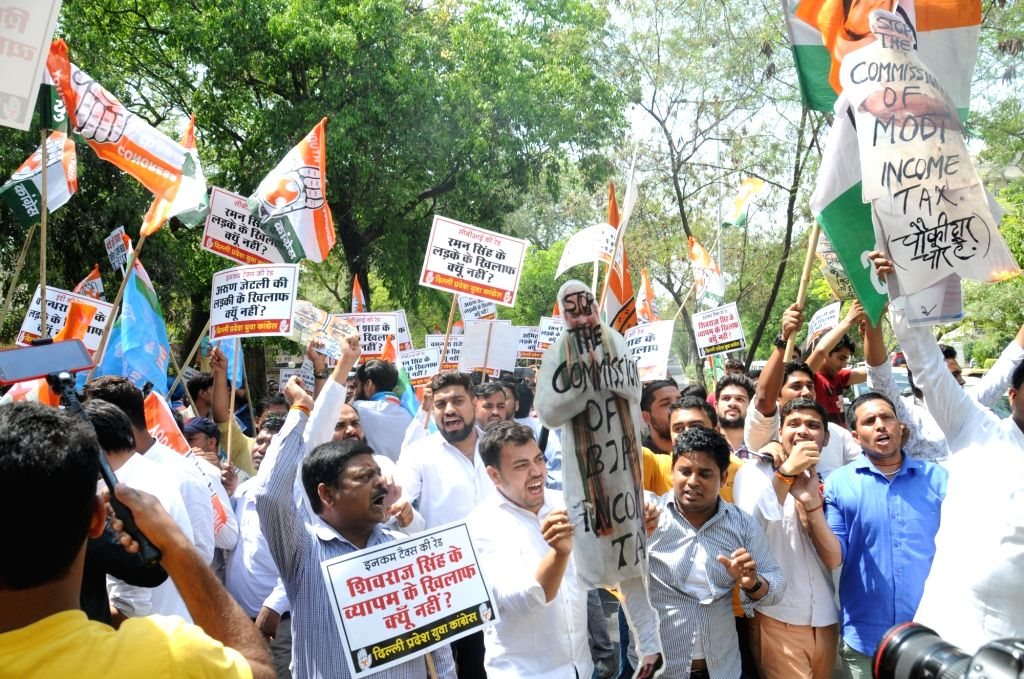 Youth Congress activists stage a demonstration against Income Tax in New Delhi, on April 10, 2019.