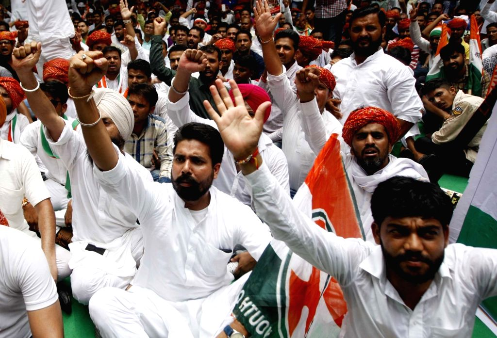 Youth Congress activists stage a protest against Union Government in New Delhi on Aug 10, 2017.