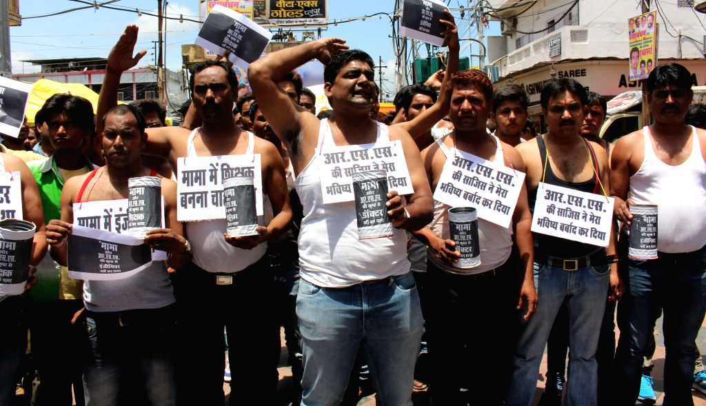 Youth congress activists staging a demonstration against state government demanding CBI probe on Vyapam scam in Bhopal on August 2, 2014.