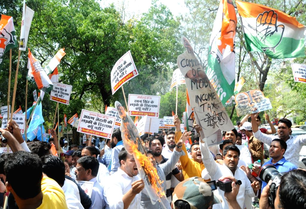 Youth Congress and National Students' Union of India (NSUI) activists stage a demonstration against Income Tax in New Delhi, on April 10, 2019.