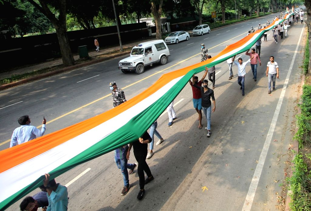 Youth Congress Members participate in Tiranga March on the occassion of Gandhi Jayanti The Birth Anniversary of the Father of The Nation Mhatma Gandhi in New Delhi on Saturday October 02,2021 ...