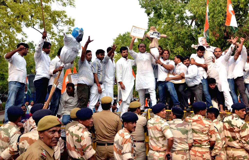 Youth Congress workers demonstrate against journalist Ved Prakash Vaidik who is in news for meeting 26/11 mastermind Hafiz Saeed during his recent Pakistan visit, at Youth Congress office in New ...