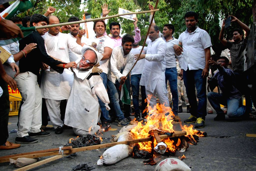 Youth Congress workers demonstrate against journalist Ved Prakash Vaidik who is in news for meeting 26/11 mastermind Hafiz Saeed during his recent Pakistan visit, in New Delhi on July 15, 2014.