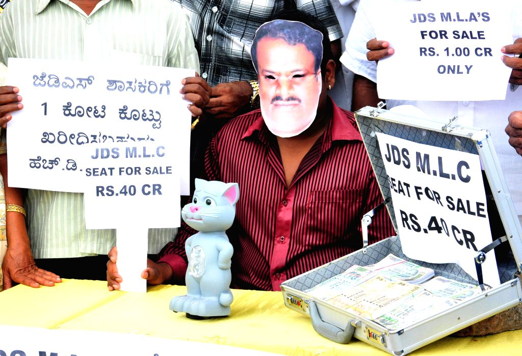 Youth Congress workers demonstrate against former Karnataka chief minister and JD(S) leader HD Kumaraswamy in Bangalore on July 7, 2014.