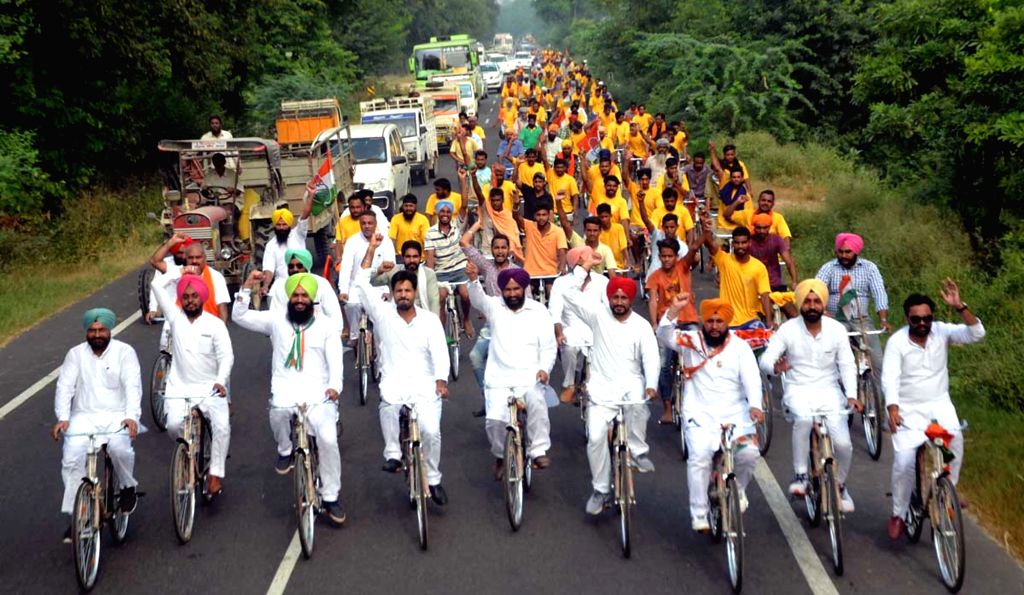 "Youth Congress workers participate during a cycle rally ""Jawani Sambhaal Yatra"" in Moga on Oct 1, 2016."