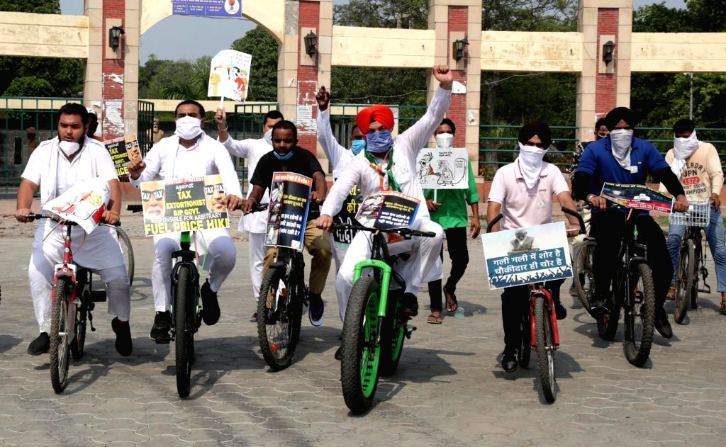 Youth Congress workers participate in a cycle rally to protest against the Central Government over fuel price hike, in Amritsar on July 14, 2020.