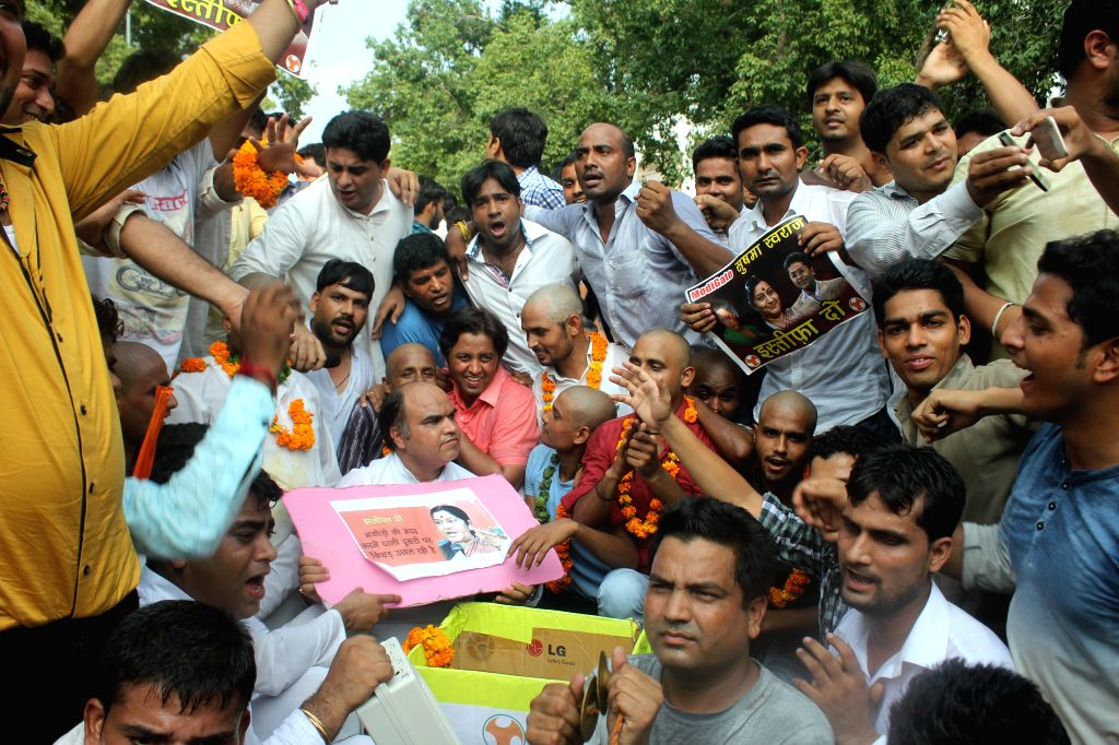 Youth Congress workers stage a demonstration in New Delhi on Aug 13, 2015.