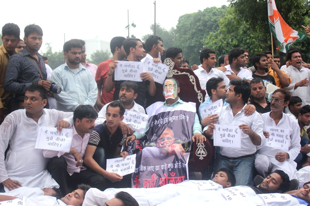 Youth Congress workers stage a demonstration to press for resignation of External Affairs Minister Sushma Swaraj in New Delhi, on Aug 11, 2015.