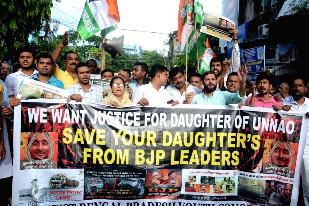 Youth Congress workers stage a demonstration to demand justice for Unnao gangrape victim, in Kolkata on Aug 2, 2019.