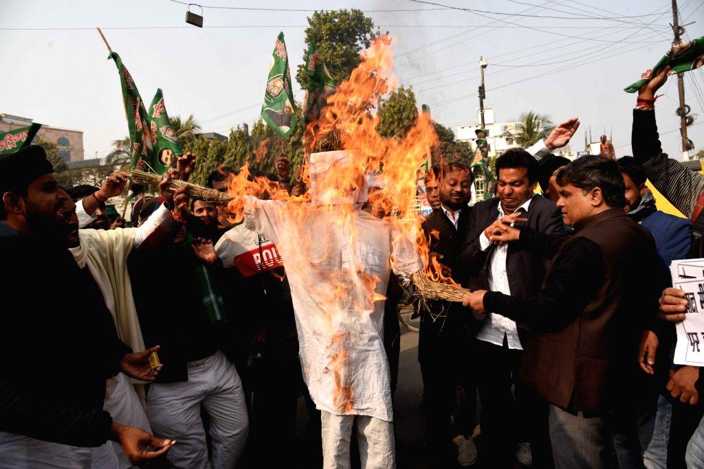 Youth Rashtriya Janta Dal workers burn effigy Bihar Chief Minister Nitish Kumar protest against in action of Social Media, In Patna on Monday January 25,2021 - Nitish Kumar