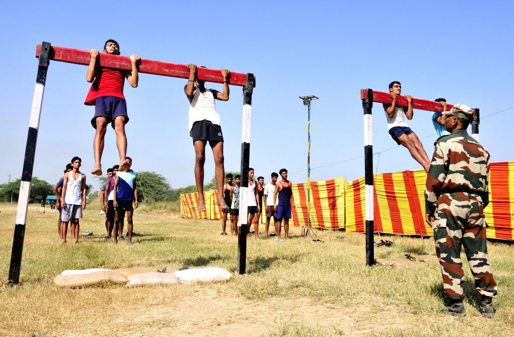 Youths participate in a physical fitness test during Indian Army's recruitment rally in Khasa, Punjab on Oct 5, 2017.