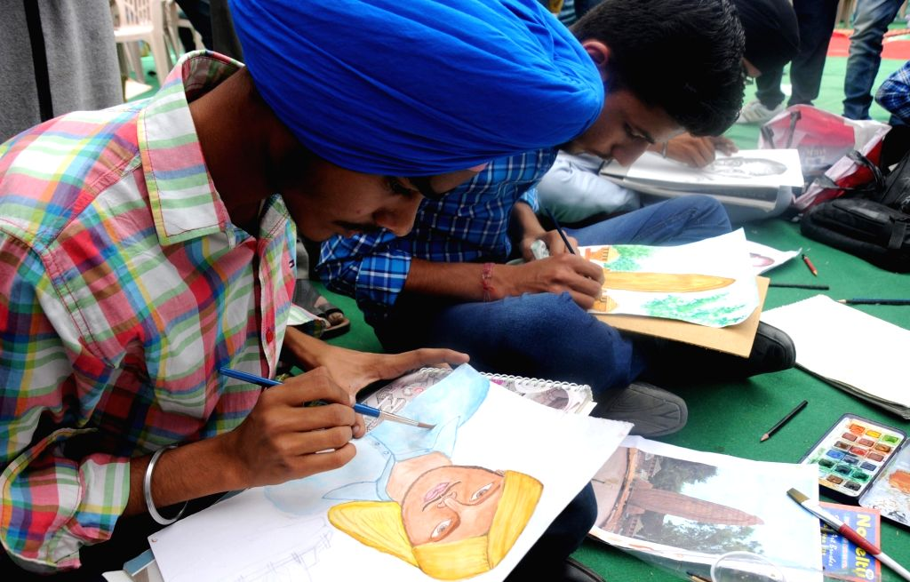 Youths particpate in a painting competition organised at Jallianwala Bagh on the 96th anniversary of Jallaianwala Bagh massacre in Amritsar on April 13, 2016.