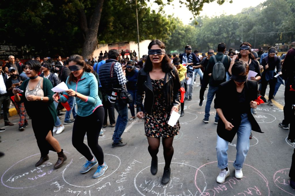 Youths staging a demonstration against the increase in rape cases and demanding justice in New Delhi on Dec. 7, 2019.