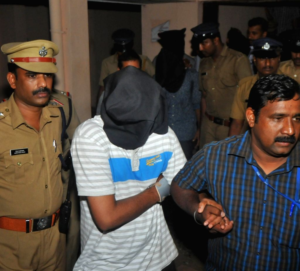 Youths suspected to be activists of Islamic State being taken to be produced before a National Investigation Agency (NIA) court in Kochi on Oct 2, 2016.
