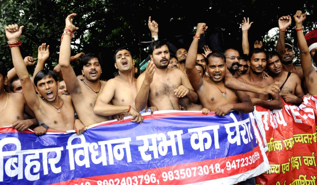 Youths who have cleared teachers' eligibility test (TET) stage a demonstration to press for their demands in Patna on Aug 13, 2014.
