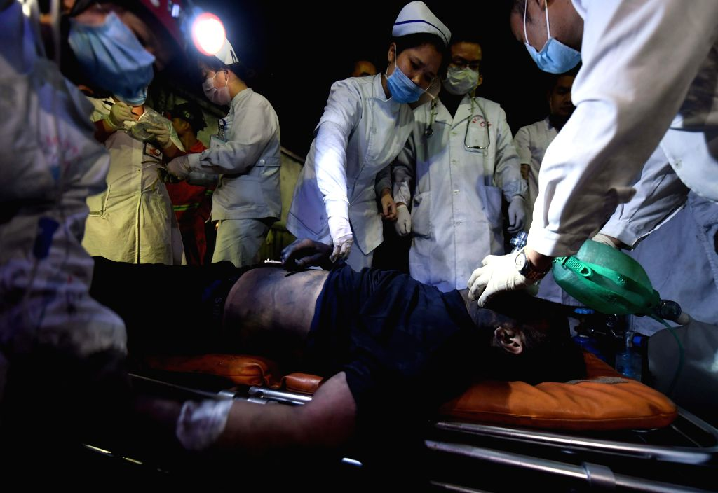 YOUXIAN, May 8, 2017 - A trapped miner receives medical treatment after being lifted from the shaft at the Jilinqiao colliery in Huangfengqiao Township, Youxian County, central China's Hunan ...