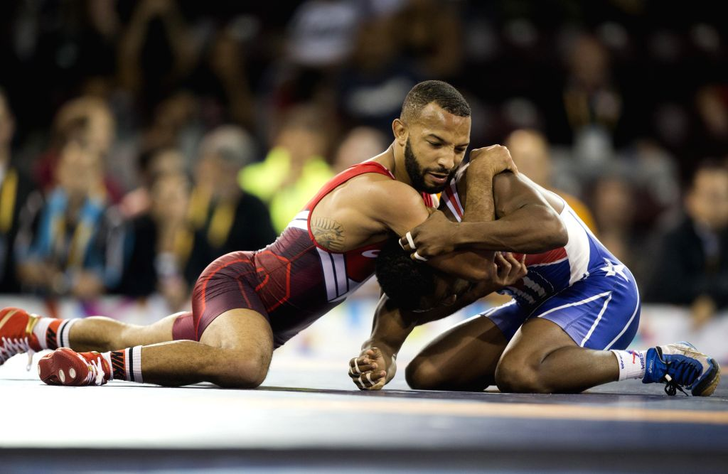 Yowlys Bonne(R) of Cuba competes with Angel Escobedo of the United States during their the men's freestyle 57kg final of wrestling event at the 17th Pan American ...