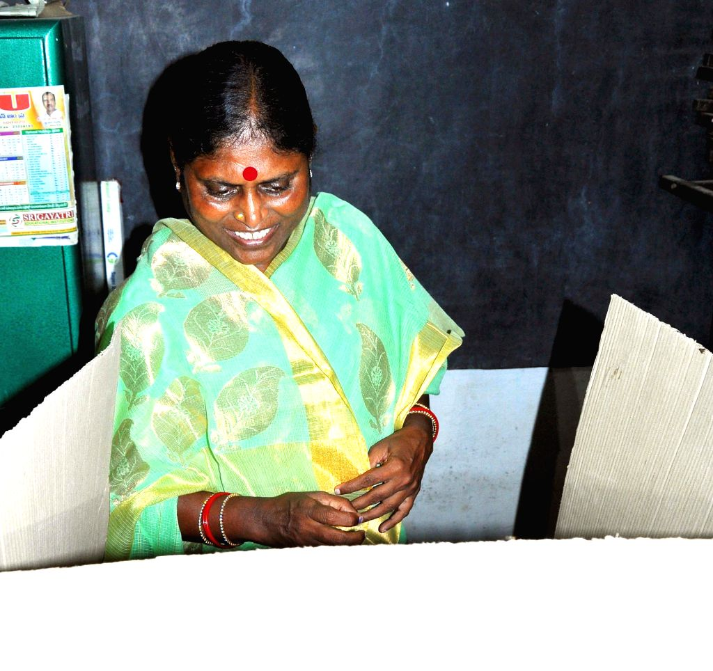 YSR Congress honorary president Y.S. Vijayalakshmi casts her vote at a polling booth during the eighth phase of 2014 Lok Sabha Polls at Pulivendula in Kadapa district of Andhra Pradesh on May 7, ...