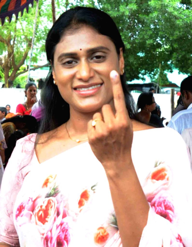 YSR Congress Party leader Y.S. Sharmila shows her inked finger after casting her vote for the first phase of 2019 LokSabha elections in Andhra Pradesh's Pulivendula on April 11, 2019.