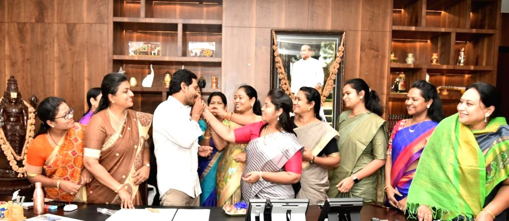 YSR Congress Party MLAs offer sweets after tying rakhis to Andhra Pradesh Chief Minister YS Jagan Mohan Reddy to celebrate the clearance of A.P. Disha Bill, 2019 (A.P. Criminal Law ... - Jagan Mohan Reddy
