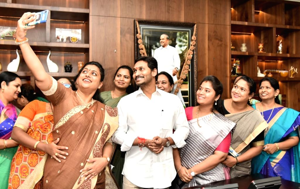 YSR Congress Party MLAs pose for selfies with Andhra Pradesh Chief Minister YS Jagan Mohan Reddy after tying rakhis to him to celebrate the clearance of A.P. Disha Bill, 2019 (A.P. ... - Jagan Mohan Reddy