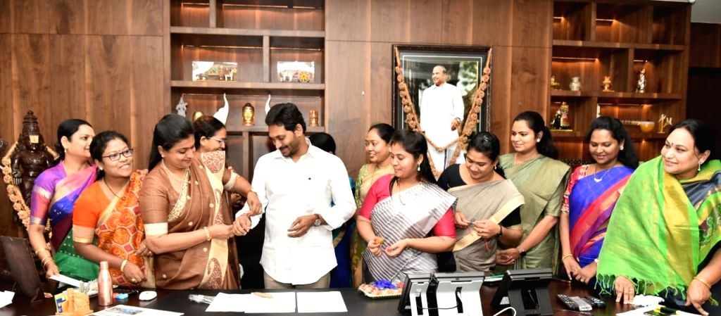 YSR Congress Party MLAs tie rakhis to Andhra Pradesh Chief Minister YS Jagan Mohan Reddy to celebrate the clearance of A.P. Disha Bill, 2019 (A.P. Criminal Law (Amendment) Bill, 2019) ... - Jagan Mohan Reddy