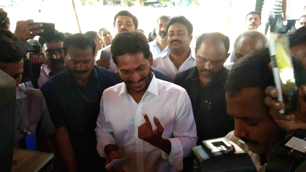 YSR Congress Party President Y.S. Jagan Mohan Reddy shows his inked finger after casting his vote for the first phase of 2019 Lok Sabha elections in Andhra Pradesh's Kadapa on April 11, 2019. ...