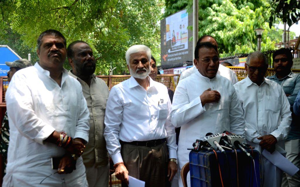 YSR Congress Party (YSRCP) leader Mekapati Rajamohan Reddy accompanied by party leaders Botsa Satyanarayana, V. Vijayasai Reddy and Ummareddy Venkateswarlu, talks to media persons after ... - Mekapati Rajamohan Reddy and V. Vijayasai Reddy