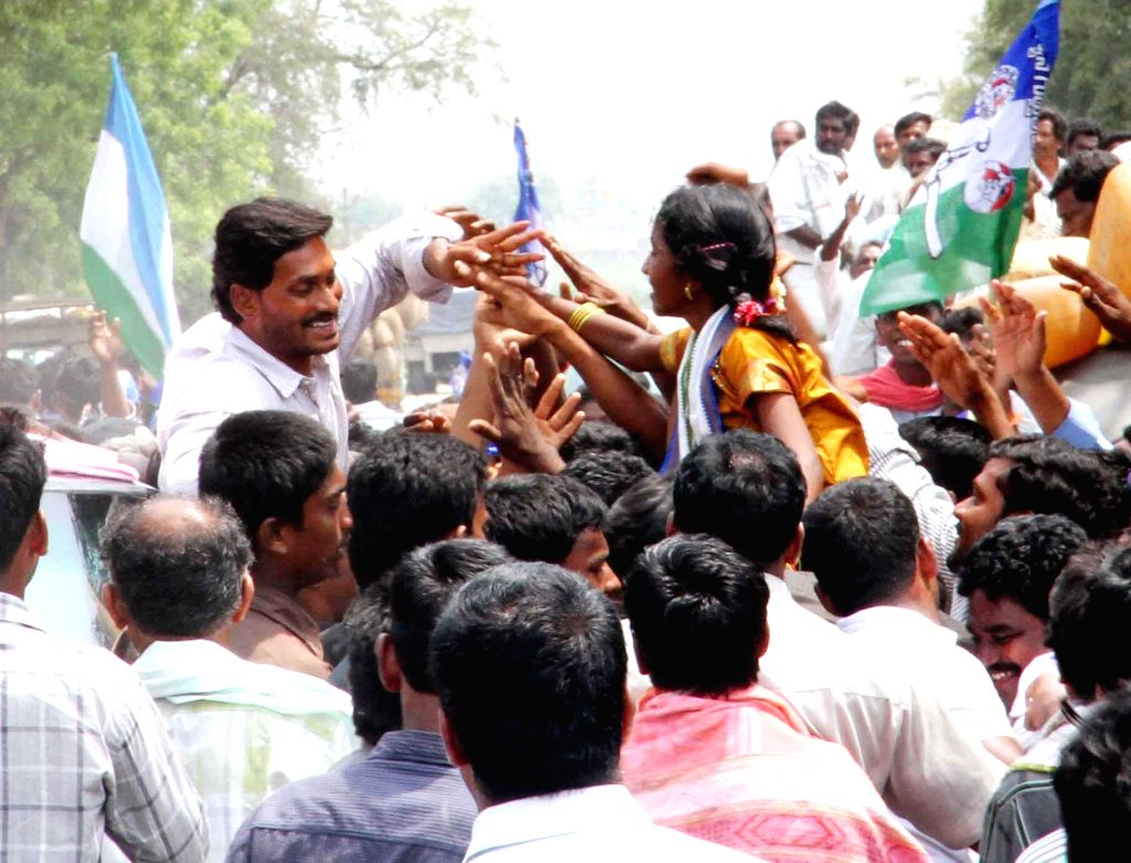 YSR Congress president Y.S. Jagan Mohan Reddy interacts with public during an election campaign in Guntur district of Andhra Pradesh on April 23, 2014.