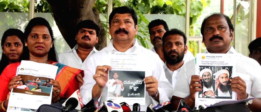 YSRCP leaders display the printouts of alleged objectionable social media posts put up by the TDP against the party ahead of meeting Andhra Pradesh Director General of Police Damodar ...
