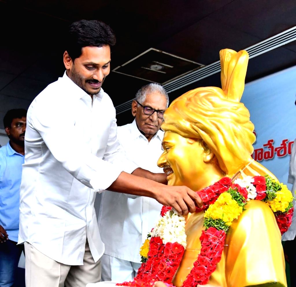 YSRCP president Y.S. Jagan Mohan Reddy pays tributes to Y S Rajasekhara Reddy at YSRC Legislature Party meeting at party president Y.S. Jagan Mohan Reddy's residence in Tadepalli, Andhra ...