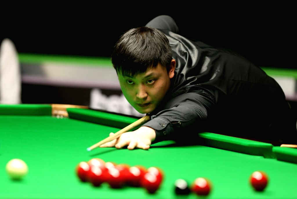 Yu Delu of China competes during his second round match against Marco Fu of Chinese Hong Kong at Snooker UK Championship 2015 in York, England on Nov. 28, 2015. Yu ...