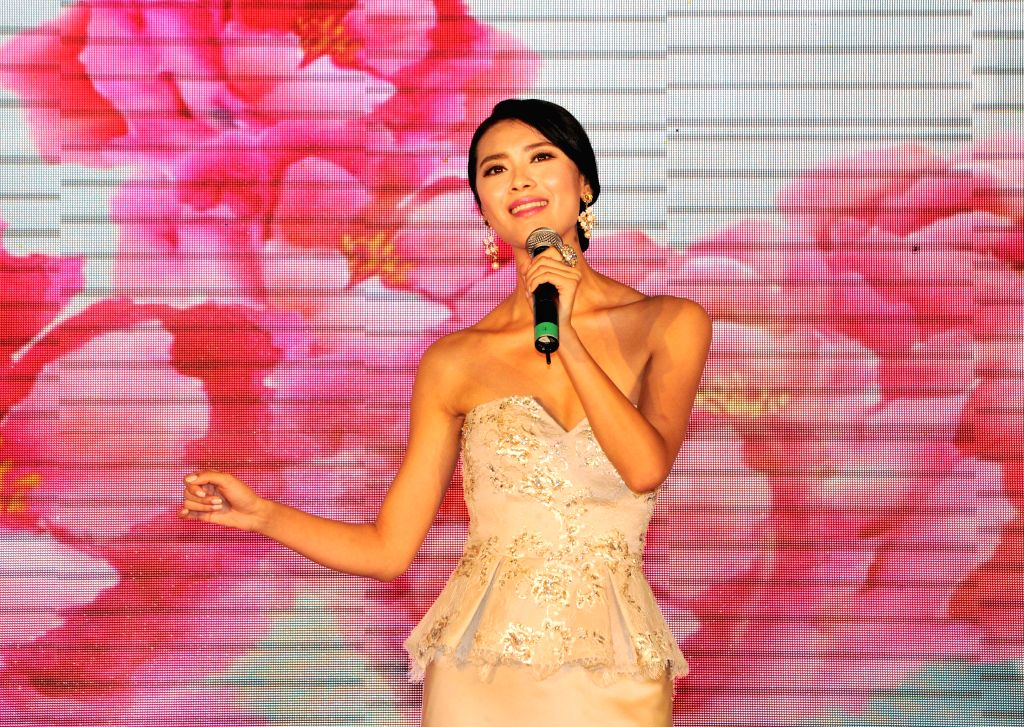 Yu Wenxia, who was crowned Miss World 2012, sings at a press conference in Sanya, south China's Hainan Province, Aug. 6, 2015. Miss World Organization announced at ...